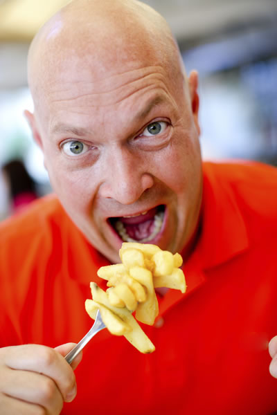 Dude ready to inhale a big forkful of fries