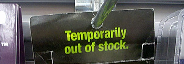 "A ""temporarily out of stock"" sign on a store shelf"