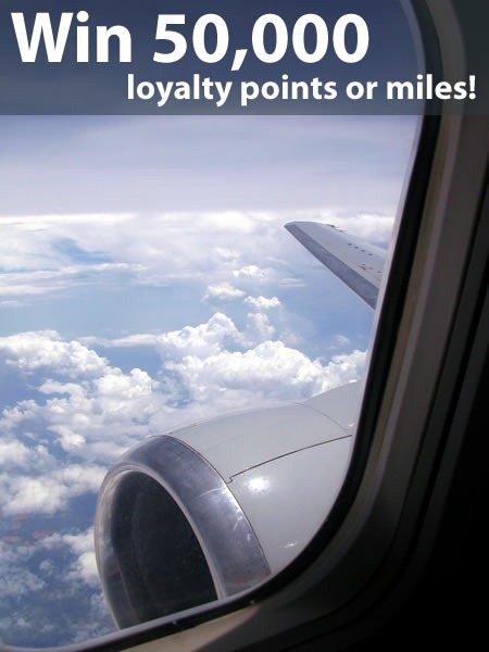 """Win 50,000 loyalty points or miles!"": Airplane wing as seen from window"
