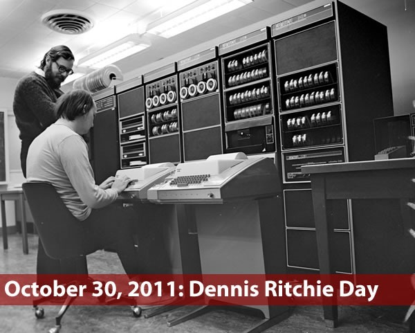 """October 30, 2011: Dennis Ritchie Day"": Old photo of Dennis Ritchie and Ken Thomson working on a DEC PDP computer"