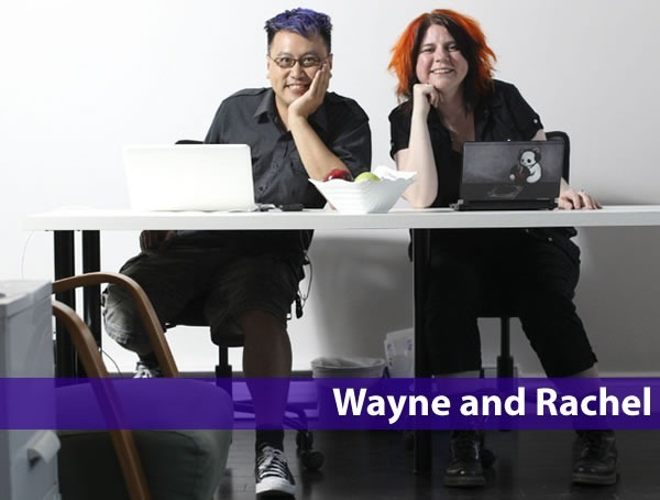 Photo of Wayne Lee and Rachel Young, sitting side by side at a desk with their laptops