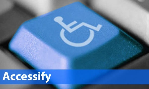 """Accessify"": Computer keyboard with highlighted blue key with wheelchair symbol"