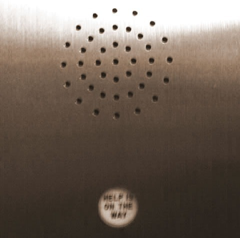 """Help is on the way"" indicator on an elevator's control panel"