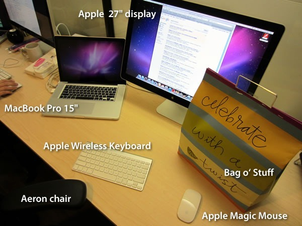 "15"" MacBook Pro, Apple Wireless Keyboard, Aeron chair, Apple Magic Mouse, Bag o' Stuff, Apple 27-inch display"