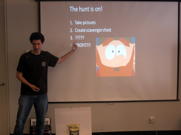 "A hakcer at HackVan 2011 presenting his app: ""1. Take pictures. 2. Create scavenger chest. 3. ???? 4. PROFIT!!!"""