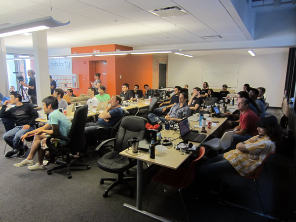 The HackVan attendees watching the presentations
