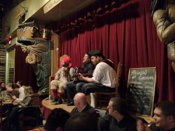 Joey deVilla playing accordion onstage with the pirates at Le Cabaret du Roy.