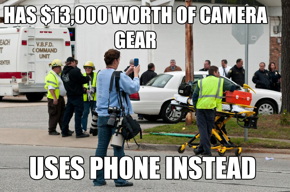 "Photojournalist taking photo at the scene of an F-18 crash. She has lots of expensive camera equipment with her, but she's shooting a picture with her iPhone. Caption: ""Has $13,000 of camera equipment / Uses phone instead"""