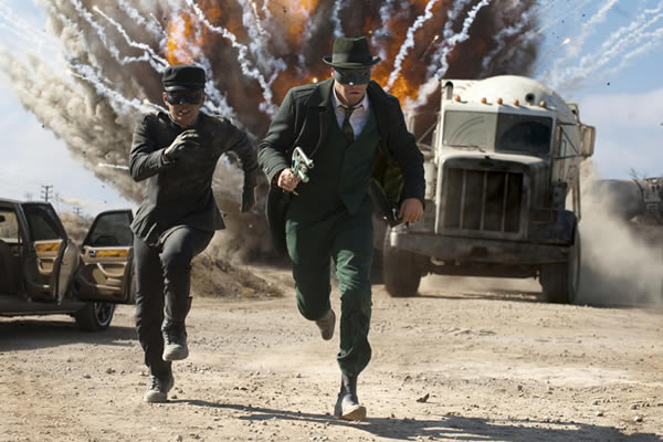 Green Hornet and Kato running away from an explosion