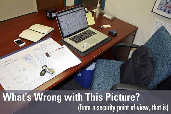 "Typical office desk with a laptop, smartphone, keys and laptop bag on it - ""What's wrong with this picture? (From a security point of view)"""