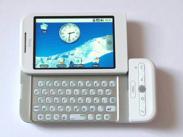 HTC Dream phone, shown in landscape mode with the sliding keyboard extended.