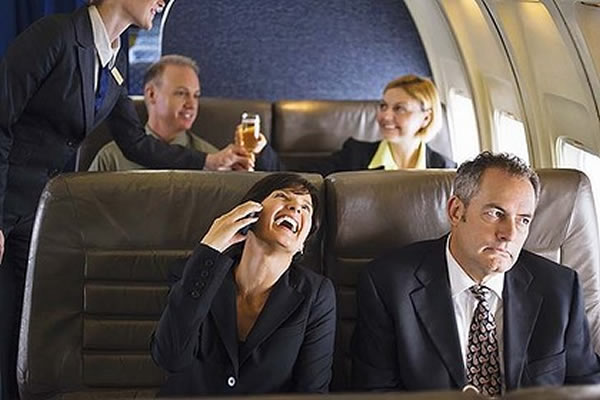 talking on a phone on a plane