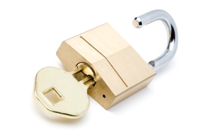 Gold Key Opening a Gold Lock (with Clipping Path)