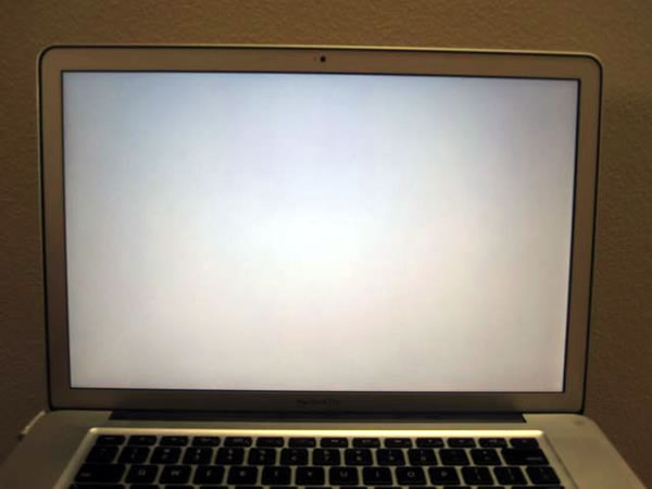 Photo: MacBook Pro showing a bank gray screen.