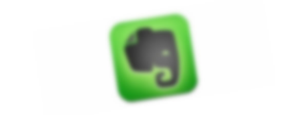 An out-of-focus Evernote icon.