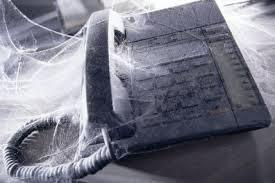 phone covered in cobwebs