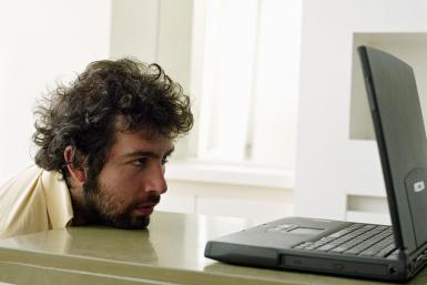 sad man at computer