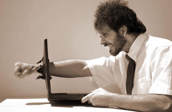programmer punching through laptop screen