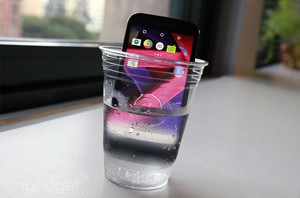 moto g in glass of water