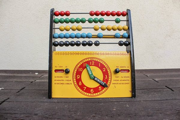 abacus with toy clock