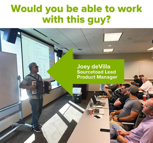 Would you be able to work with this guy? (Photo of Joey deVilla on accordion performing in front of a room full of developers.)