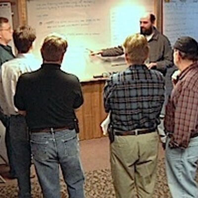 Photo: Some of the signers of the agile manifesto gathered around a whiteboard at their Snowbird get-together.