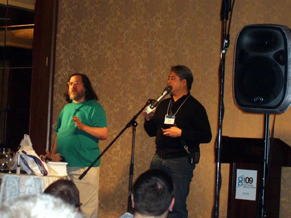 Photo: Richard M. Stallman and Joey deVilla onstage.