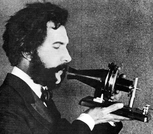 Photo: Alexander Graham Bell speaking into his telephone.
