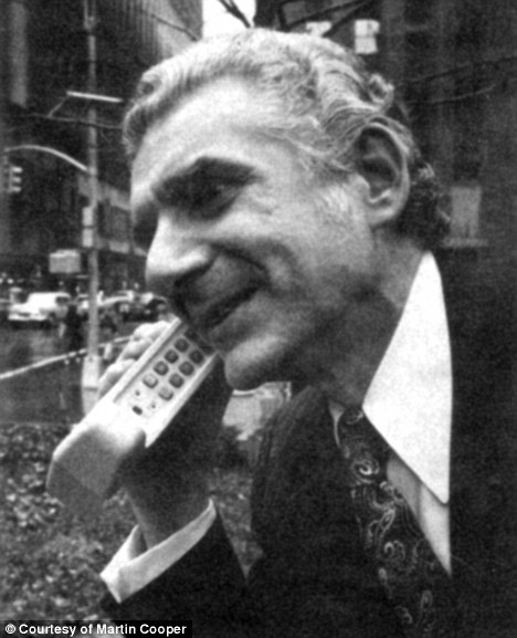 Photo: Martin Cooper on an old-style cellular phone.