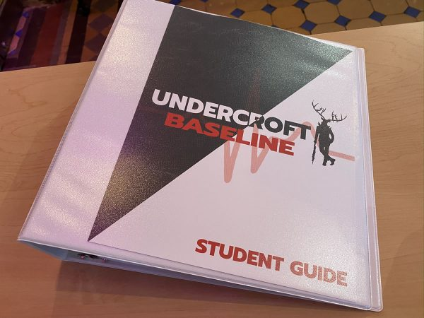 "Photo: A three-ring binder labeled ""Undercroft Baseline Student Guide""."