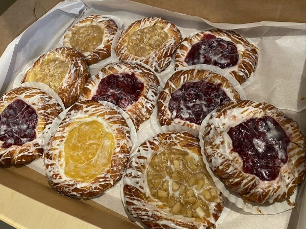 Photo: An assortment of apple and cherry danish pastries.