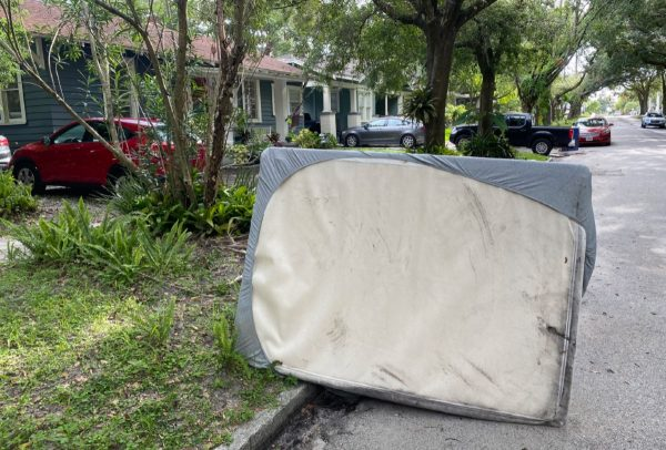 Photo: Old mattress on the side of the road, waiting for pickup