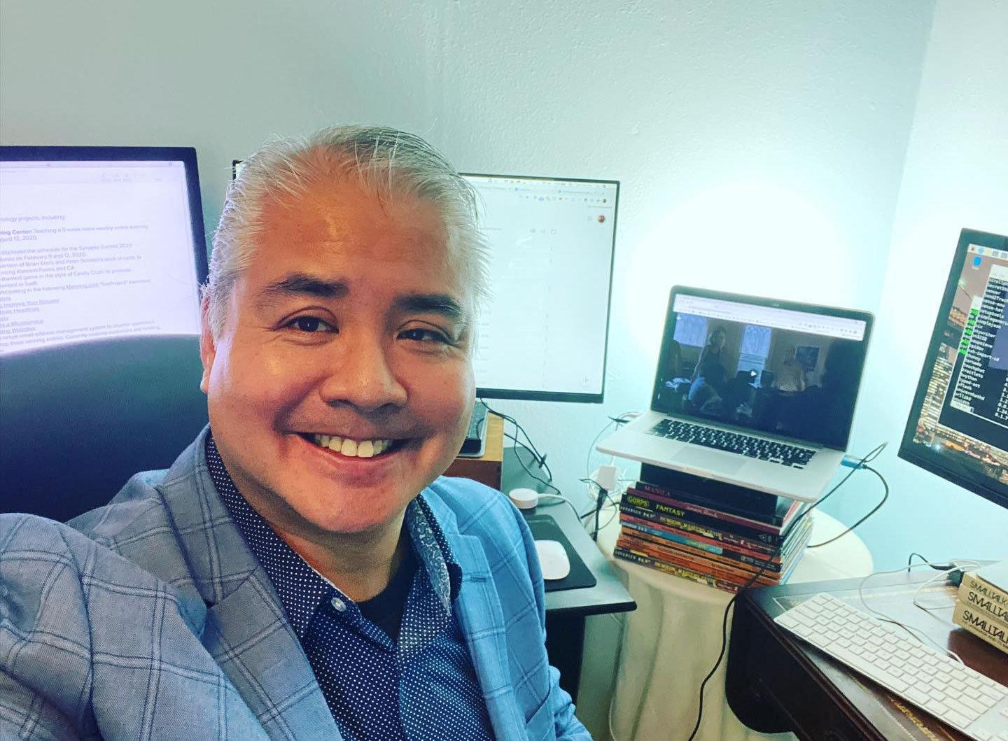 "Photo: ""Selfie"" featuring Joey deVilla in a sport jacket and dress shirt sitting at his desks in his home office, with MacBook Pro and three monitors in the background."