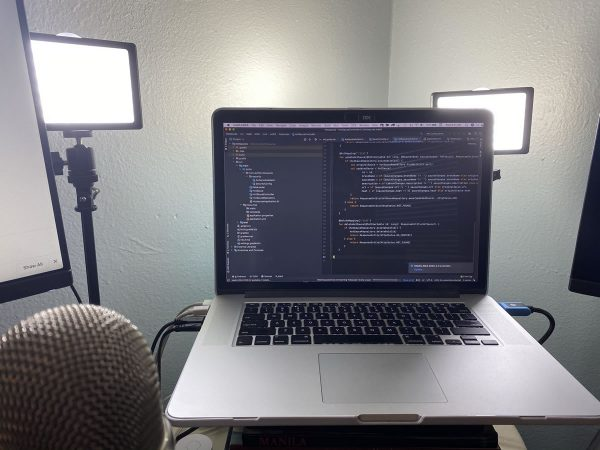 Photo: Joey's MacBook Pro, with videochat lighting in the background.