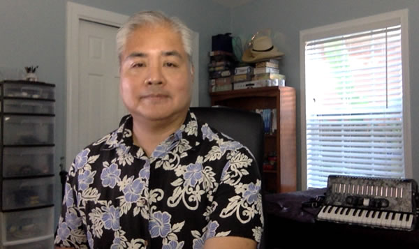 Photo: Joey deVilla in his home office, with his accordion in the background.