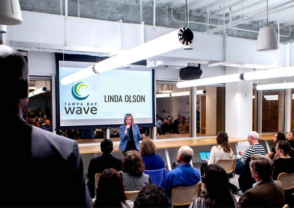 Photo: Linda Olson speaks at a Tampa Bay Wave presentation.