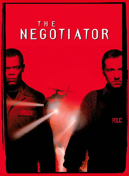 "Poster for the 1998 film ""The Negotiator"", featuring Samuel L. Jackson and Kevin Spacey."